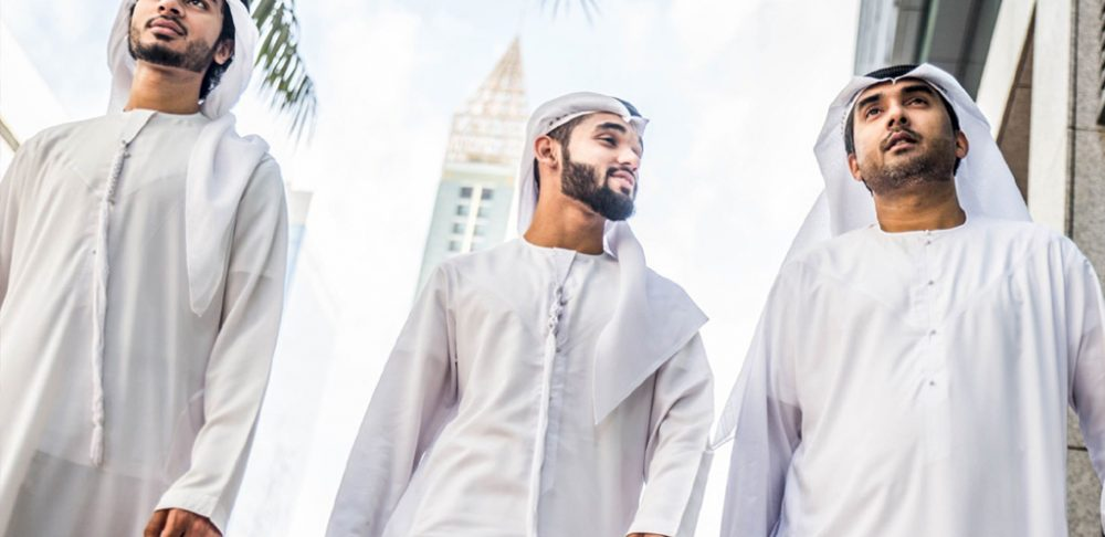 emirati men wearing traditional dress