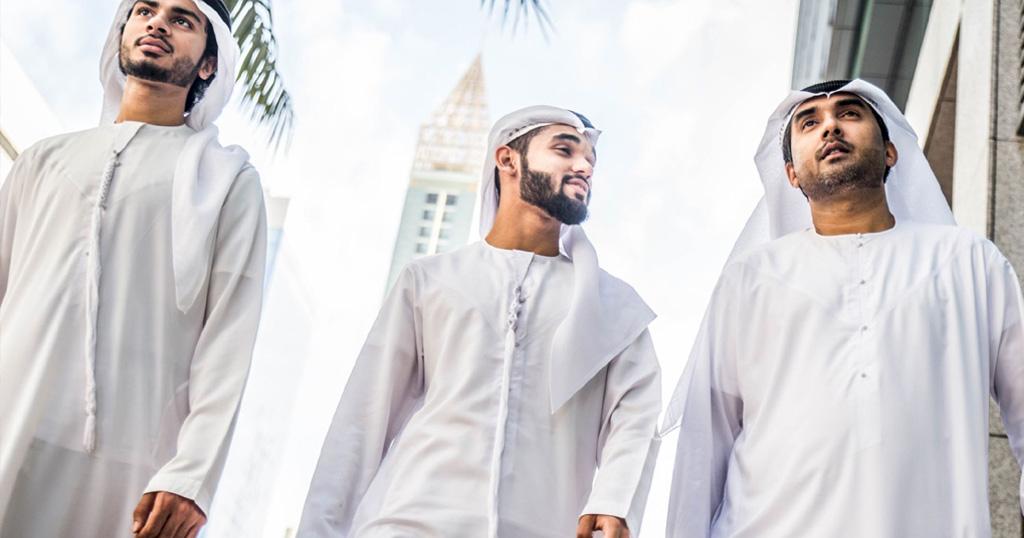 emirati men wearing traditional dress