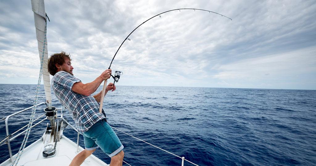 Man fishing on a yacht