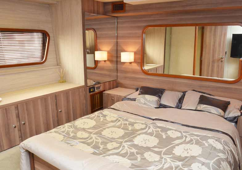 Elegant bedroom of the 70 feet yacht