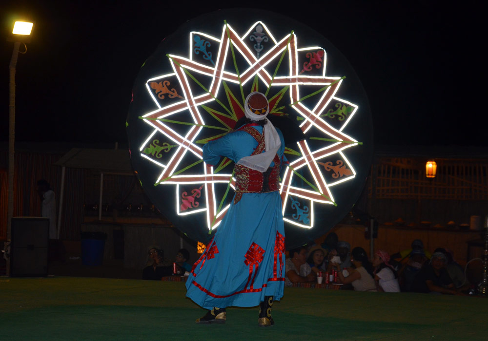 Traditional Tanoura dance performance in the desert camp