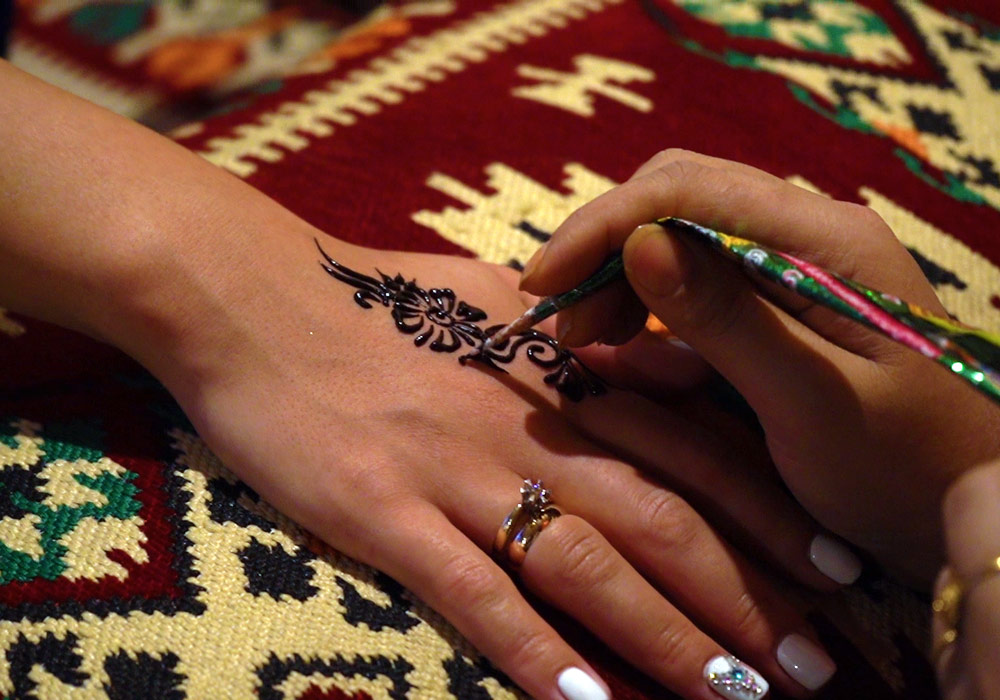 Get an Arabic style tattoos to make your trip more attractive